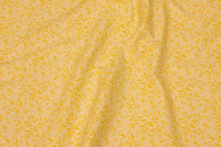 Lemon-yellow patchwork cotton with yellow leaf-pattern