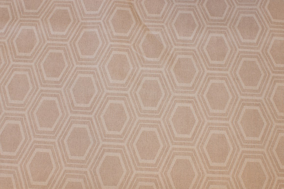 Light sand-colored coated fabric with pattern