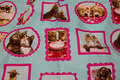 Mint-green patchwork cotton with cats-and dog portraits.