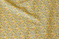 Organic cotton in soft yellow with flowers in dust-colors