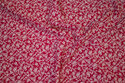 Red, firm cotton with off white flowers