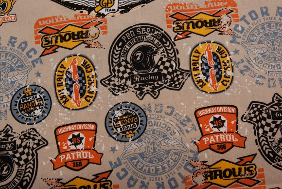 Sand-colored cotton with motor-theme and logos