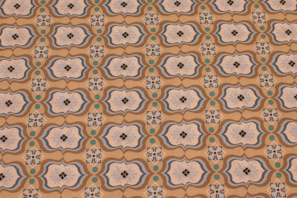 Sand-colored patchwork cotton with light blue pattern