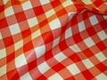 Coated fabric for tablecloth with blue+white or red+white checkers. Great for any table where people or perhaps kids will be spilling stuff. Checkers are ca. 1x1 inch. Is waterproof and can be whiped with a wet rag.