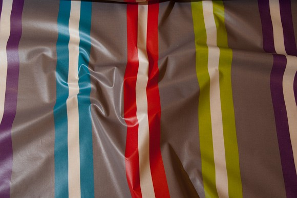 Grey coated textile with colored stripes