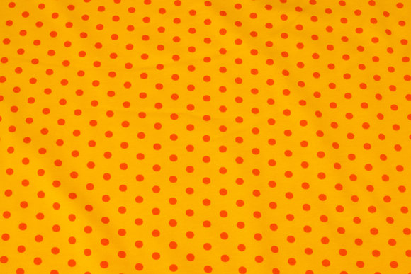 Yellow cotton-jersey with orange 8 mm dots