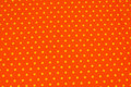 Orange cotton-jersey with yellow 8 mm dots