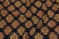 Black batique-cotton with golden pattern.