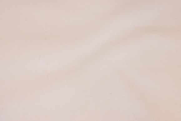 White flannel with rubber-core to secure bed