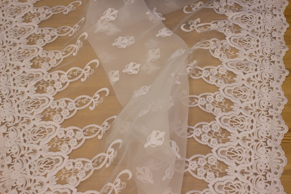 White organza with embroidery with pearls in both sides