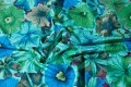 Green-blue patchworkfabric with flowers