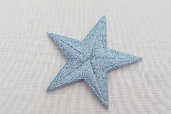 Lightblue star iron-on patch, diameter 5 cm