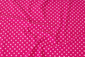 Pink cotton-jersey with 8 mm soft red dots