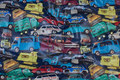 Coated navy blue quilt with cars.