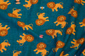 Petrol coloured cotton-jersey with ca. 3 cm lions