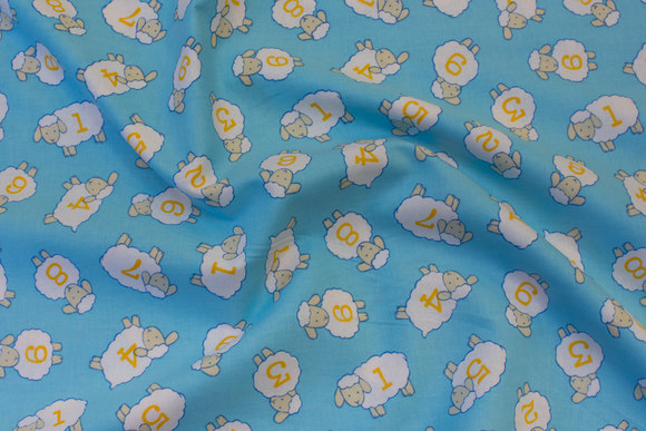 Light blue patchwork cotton with small sheep