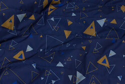 Light coated quilt in navy with cinnamon triangles