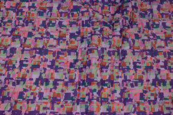Light coated quilt in purple and soft red with navy back