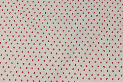 Medium-thickness linen and cotton linen-colored with small winter-red hearts