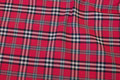 Red-checked cotton and polyester.