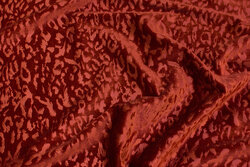 Silky stretch-velvet in rust-colored with surface-textured pattern