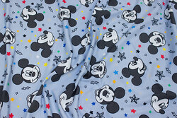 Cotton-jersey in dusty light blue with ca. 6 cm Mickey Mouse heads