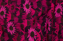 Cotton-jersey with pink and fuchsia flowers on eggplant-colored base
