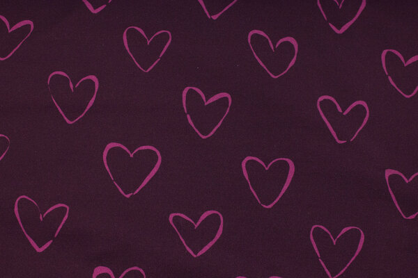 Eggplant-colored, softened sweatshirt fabric with ca. 4 cm pink hearts