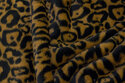 Supersoft jaguar-fur-fabric in dark colors