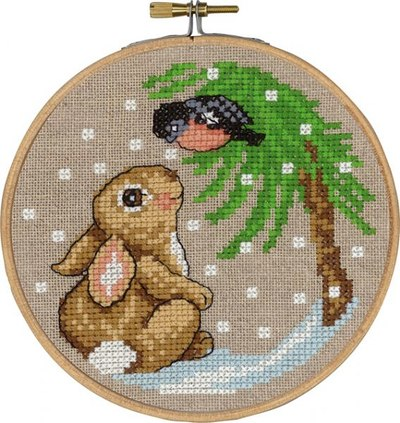 Rabbit and bird in tree, winther embroidery