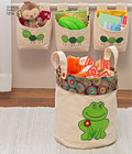 Organizers include fabric baskets in three sizes, adorable sheep applique for large basket and frog applique for medium basket, hanging caterpillar organizer, and bedside organizer for convenient storage.