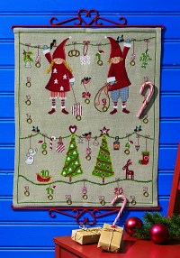 Christmas calendar in linen color with cute elfs, trees etc.. Permin 34-2260.