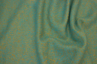 Beautiful coat-wool in light turqoise-green with golden speckles