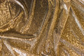 Beautiful gold-sequins-fabric with small, close-fitting, sewn-on mini-sequins