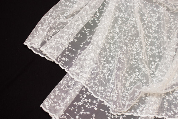 Beautiful, off white tulle-lace with small branch-pattern in shiny embroidery