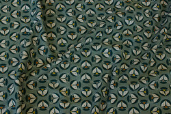 Dusty-green cotton-jersey with ca. 2 cm fox heads