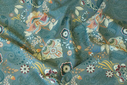 Dusty-green cotton-jersey with golden pattern in paisley-stil