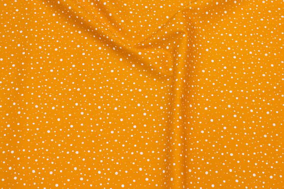 Firm cotton in ocher-yellow with white dots