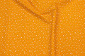 Firm cotton in ocher-yellow with white dots.