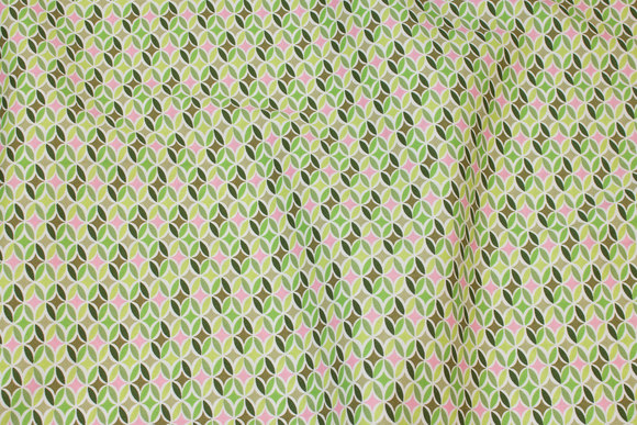 Firm cotton with small retro-pattern in green nuances with lidt pink
