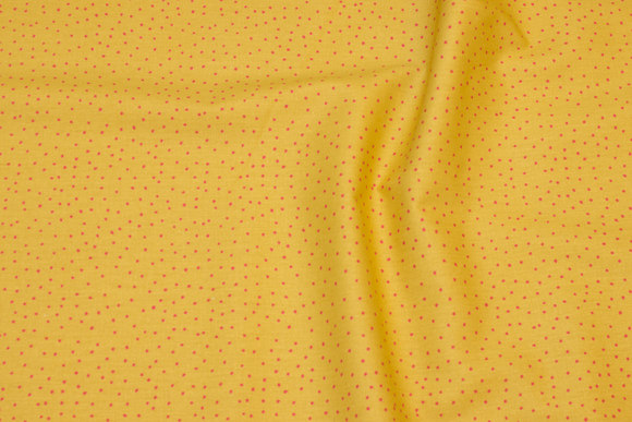 Firm cotton in straw-yellow with pink mini-dots