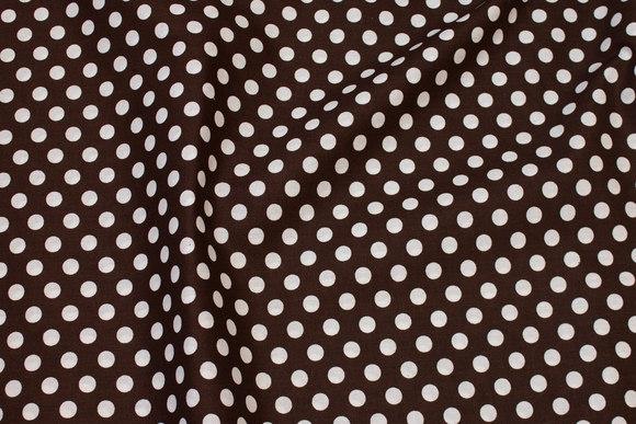Firm, dark-brown cotton with 9 mm white dot