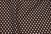 Firm, dark-brown cotton with 9 mm white dot