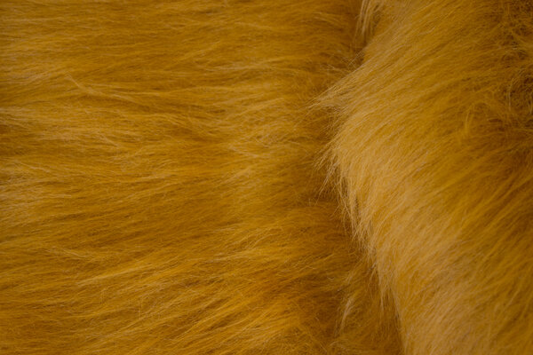 Long-haired, faux fur in lion-colored golden-brown