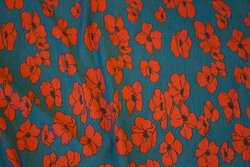 Soft modaljersey in petrol with rust-red flowers