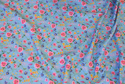 Organic cotton-jersey in sky-blue with flowers