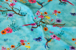 Light turqoise cotton-jersey with branches and birds