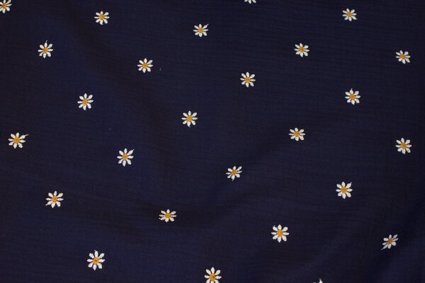 Double woven cotton (gauze) in navy with small embroidery daisies