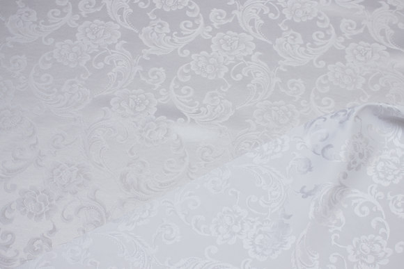 White jacquard-woven polyester satin with flower motif
