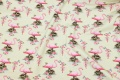 Light green cotton-jersey with pink flamingos